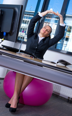 business woman stretching in office